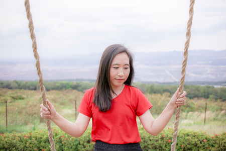 Pretty asian women with colorful sunn hemp field, summer freedom concept , Ecstatic girl taking pleasure in summer day