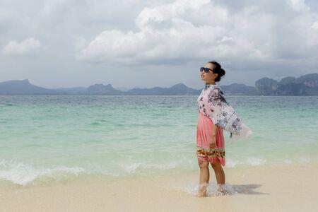 a woman so happy on beach in summer time Standard-Bild - 128963823