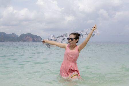 a woman so happy on beach in summer time Standard-Bild - 128963826