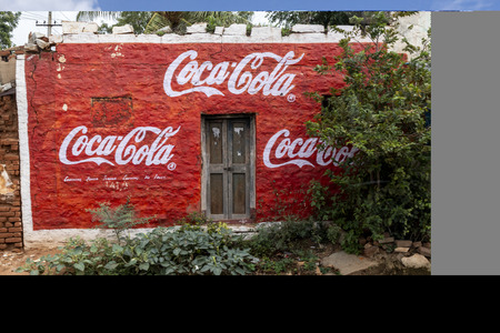 Hampi, India - 26 Aug 2019 : coca-cola wallpaper ad handmade painting Standard-Bild - 129268598