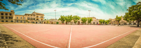 winning pitch: An ababdoned red football field in Majorca, Spain Editorial