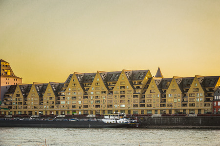 urban redevelopment: Redeveloped storehouses (so called Siebengebirge in Rheinauhafen, City of Cologne), taken from the opposite side of the Rhine Stock Photo