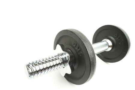 Gym dumbbell on a white background with writing space Reklamní fotografie