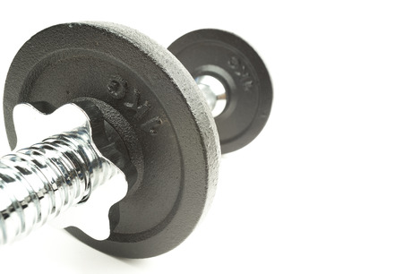 Exercise dumbbell on a white background with writing space