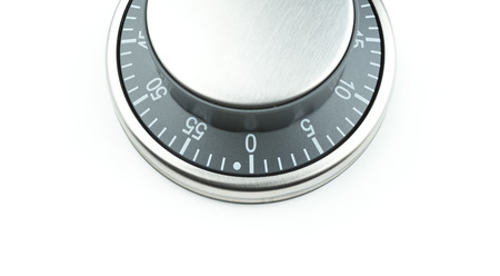 Chrome control knob  dial  button on a white background with text space. Potential use as a timer, thermostat, countdown indicator, launch button or bank safe vault entry dial.