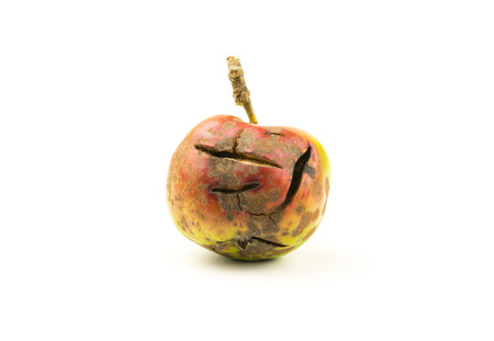 Cracked red apple on a white background with text space. Forbidden fruit  unhealthy diet concept Stock Photo