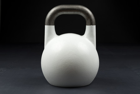 White 10kg competition kettlebell on the floor of a weight training gym Reklamní fotografie