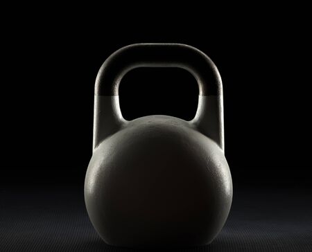 Backlit white competition kettlebell silhouette on a gym floor with potential text  writing  copy space on and above kettlebell