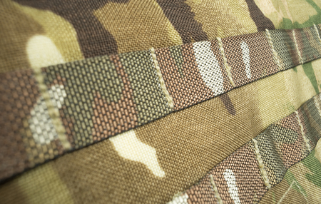 Military camouflage webbing material on a British army rucksack  backpack. Potential use as a background.