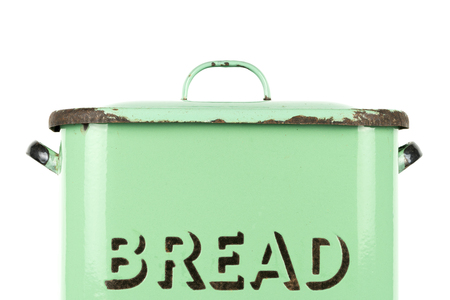 Wording on the side of a vintage 1930s British green enamel bread bin. Potential use as background for recipe  ingredients  bakery price list. Reklamní fotografie