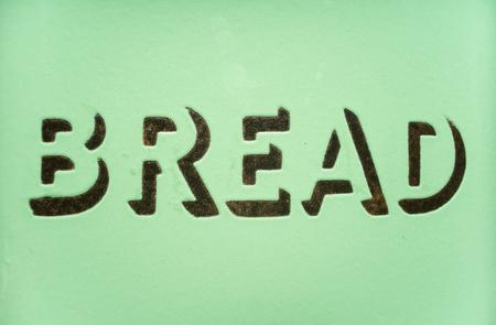 Vintage 1930s green enamel bread sign. Potential copy space above and below wording. Reklamní fotografie