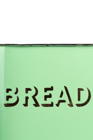Wording on the side of a vintage 1930s green enamel bread bin. Potential use as background for recipe  ingredients  bakery price list