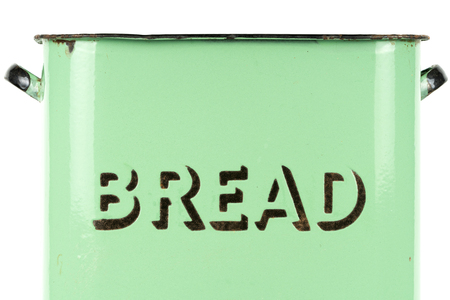 Wording on the side of a vintage 1930s green enamel bread bin. Potential use as background for recipe  menu  ingredients or bakery price list.