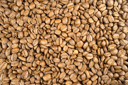 Lightly roasted brown coffee beans. Potential use as a background. Banco de Imagens