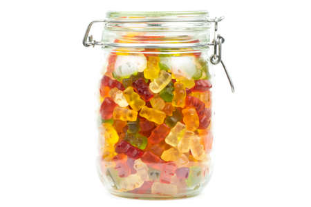 Colourful gummy bears  jelly baby candy sweets in a jar on a white background