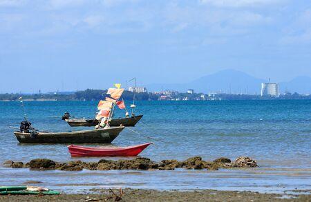Take small boats along the beach photo