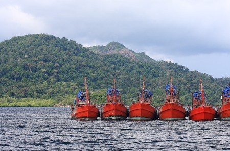 Big red boat body floating in the Andaman Sea photo