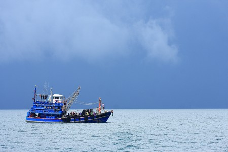 Fishing boat floating in the Andaman Sea photo
