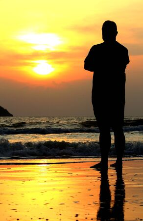 man standing in sun photo