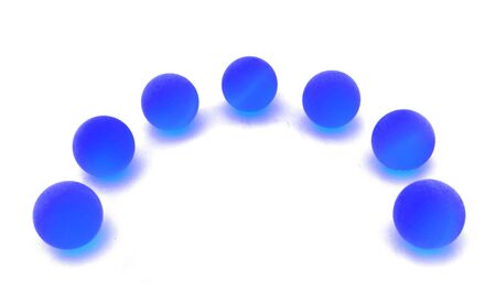 distinguish: balls arranged along circle  on white. Uniqueness concept image