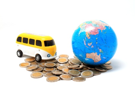 Globe and car on the pile of coins - isolated Stock Photo - 8545911