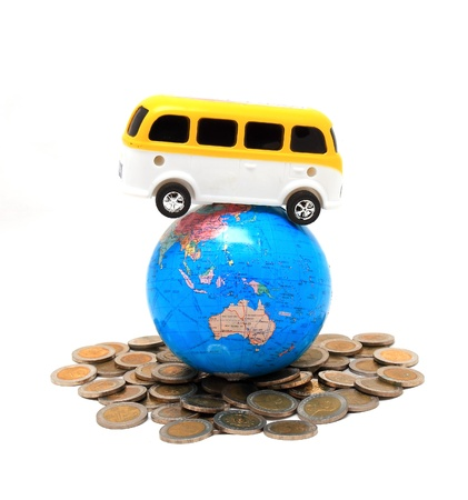 Globe and car on the pile of coins - isolated Stock Photo - 8545904