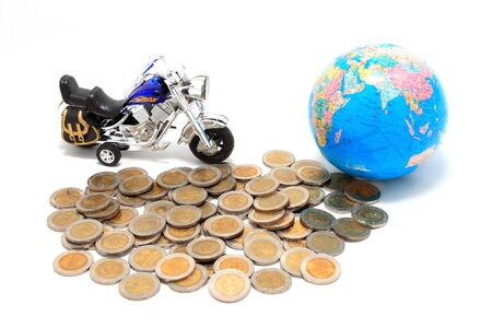 Globe and car on the pile of coins - isolated photo