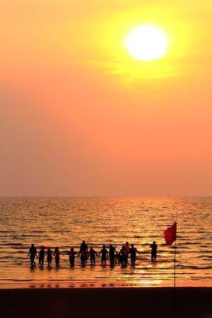 group of people enjoying the sunset photo