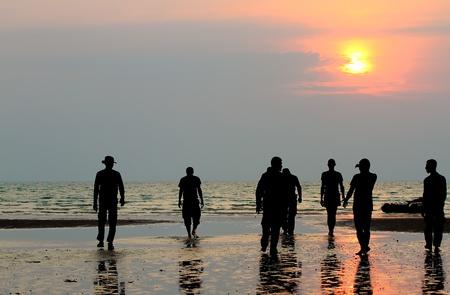 group of people enjoying the sunset Stock Photo