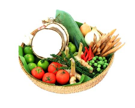 Basket full of fresh vegetables isolated on a white background Stock Photo