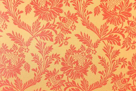 pattern with gold abstract flowers on a red background photo