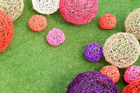 color rattan ball on green grass. photo