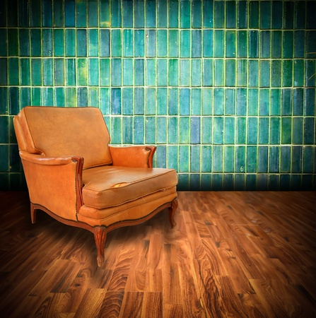vintage brown-gray chair standing beside the wall photo