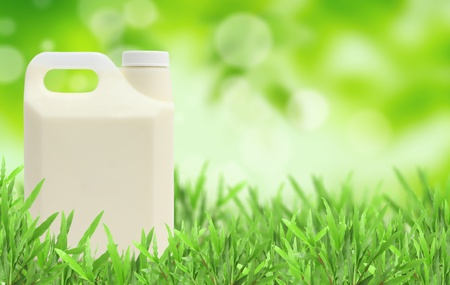glass of milk Natural green blurred background photo