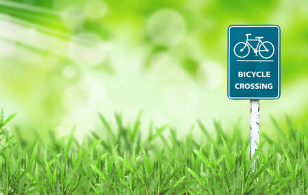 bicycle sign and green grass Stock Photo