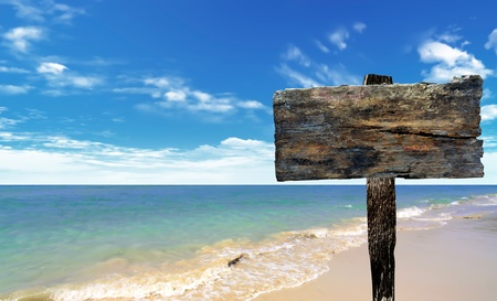 wooden sign: wood sign on beach and sea Stock Photo