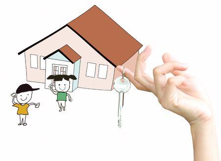 businessman hand with keys and a   house photo