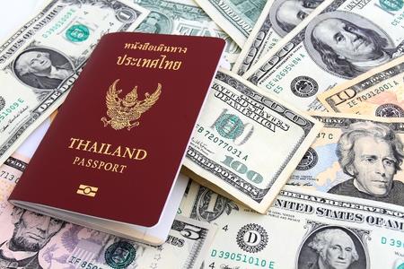 Thailand passport and dollar  money photo
