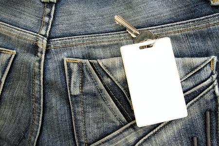 Closeup to jeans pocket with padlock photo