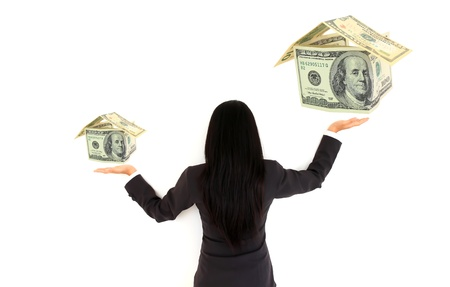 Hands and money house isolated on white background photo