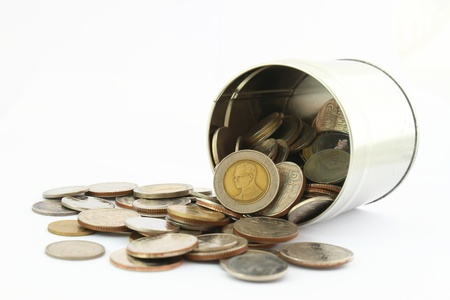 coin box: coins in a tin can . Isolated over white .