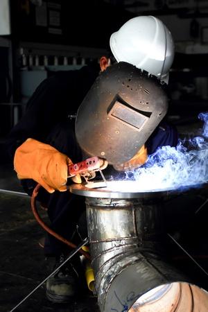 Factory welder doing his hard job