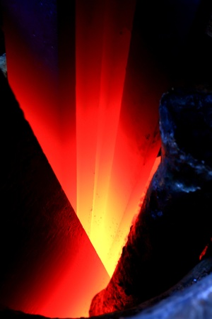 metallurgy: Iron lingot on 1000 C temperature in furnace Stock Photo