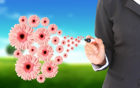 Woman's hand with flowers  on a natural background Stock Photo - 9904991