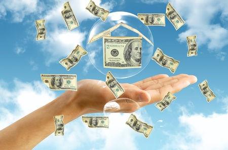 Money house in hand photo