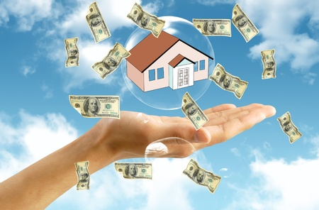 Money  and house in hand photo