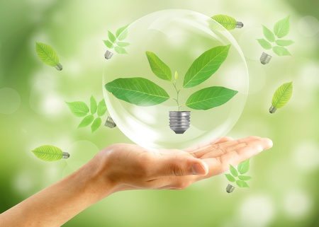 Eco concept : Hand with leaf in bubbles photo