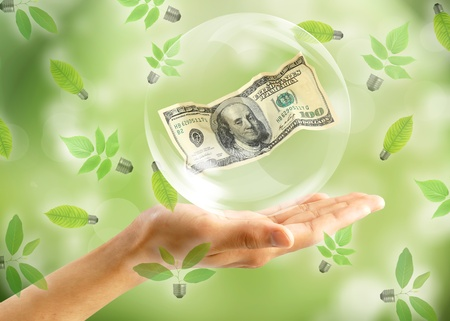Eco concept : Hand with dollar in bubbles photo