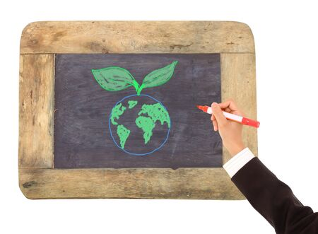drawing of the Earth surrounded   on a chalkboard photo