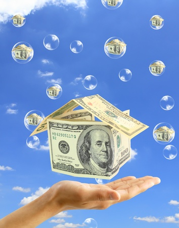 subprime mortgage crisis: Real-Estate Bubble on the background sky